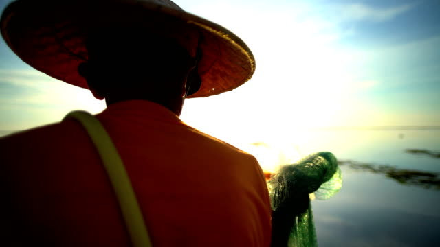 indonesian male fishing on the coastline at sunrise - headwear stock videos and b-roll footage