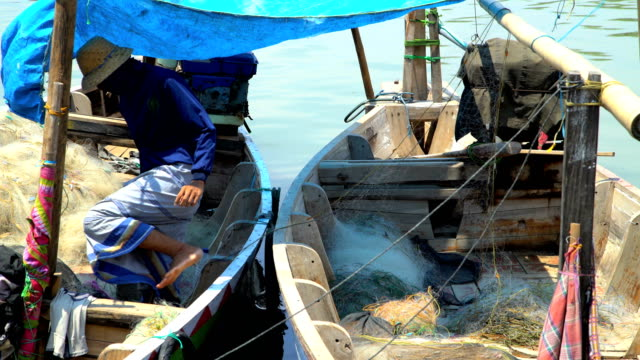 indonesian male local fishermen tending colorful boats java - probolinggo stock videos & royalty-free footage
