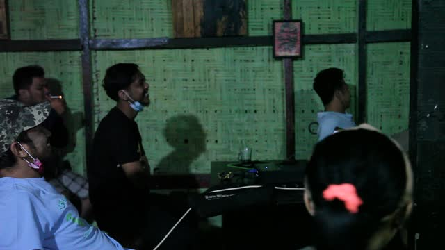 indonesian men watch the live broadcast of the uefa euro 2020 football final match between italy and england on a small screen in a coffee shop on... - editorial stock videos & royalty-free footage