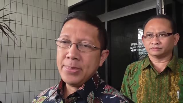 Indonesian Minister of Religious Affairs Lukman Hakim Saifuddin and Indonesian national police public information chief Agus Rianton speak to the...