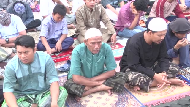 Indonesian Muslims gather to perform the Eid AlAdha prayer in the streets of Jakarta Indonesia on September 01 2017 Muslims worldwide celebrate Eid...