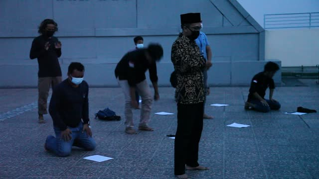 indonesian muslims perform prayers to mark the start of a total lunar eclipse at the faculty of astronomy at the muhammadiah university of north... - albert damanik stock videos & royalty-free footage