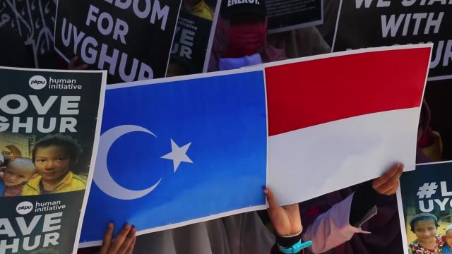 Indonesian muslims stage a protest against China's actions towards Uighurs on December 21 2018 in Aceh Indonesia
