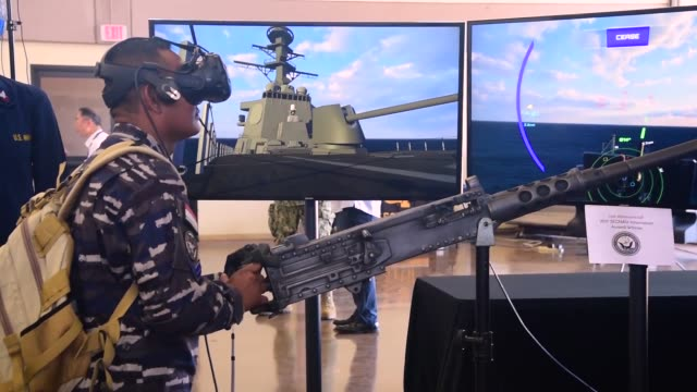 Indonesian Navy sailors wear a virtual reality headset to fire at simulated surface contacts in a program developed by the Space and Naval Warfare...
