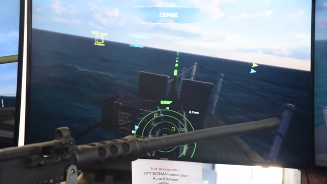 vídeos de stock e filmes b-roll de indonesian navy sailors wear a virtual reality headset to fire at simulated surface contacts in a program developed by the space and naval warfare... - pacific war