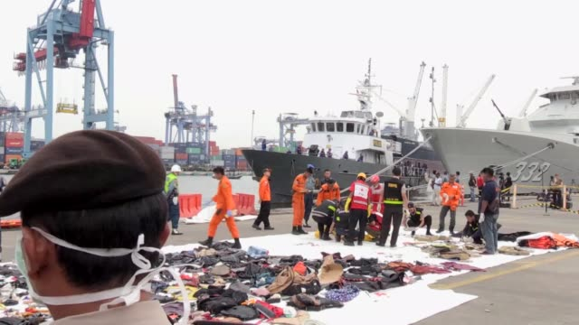 indonesian officials recover the bodies of plane crash victims and collect the remains of the crashed lion air jt 610 plane at tanjung priok port in... - crash stock videos & royalty-free footage