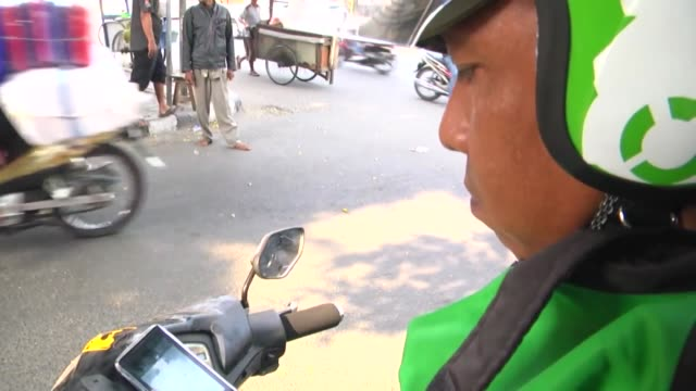 indonesian people use app gojek to avoid from jakarta traffic in jakarta indonesia on january 292017 a local startup firm created an app name gojek... - indonesia stock videos & royalty-free footage
