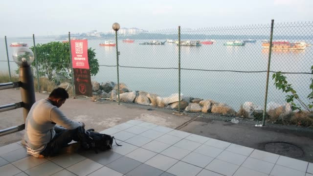 indonesian people wait for his ferry to tanjung balai in indonesia outside the terminal, ahead of eid al-fitri celebrations on june 1, 2019 in port... - port said stock videos & royalty-free footage