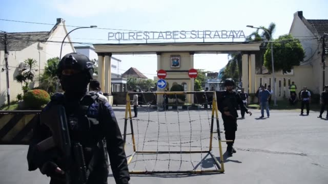 indonesian police patrol near the surabaya police headquarters after two militants on a motorcycle blew themselves wounding at least 10 people... - surabaya stock videos & royalty-free footage
