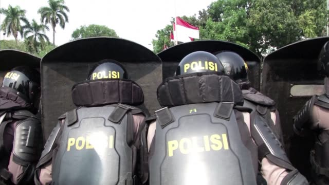 indonesian police used tear gas and water cannon to break up a rally by supporters of the ex general who lost last months presidential election - water cannon stock videos and b-roll footage