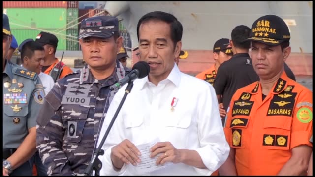 indonesian president joko widodo congratulates the diver who found the black box of lion air crash during a visit at tanjung priok port in jakarta... - boeing 737 stock videos & royalty-free footage