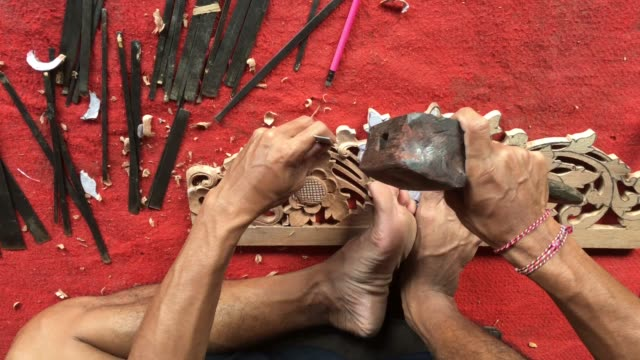 stockvideo's en b-roll-footage met indonesian wood carver carving balinese wooden artwork - carving craft product