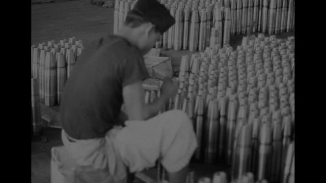 stockvideo's en b-roll-footage met vs indonesian workers pressing vertical shells men arriving at the factory men at work stations with one in foreground cleaning inside of shell men... - schild lichaamsdeel van dieren