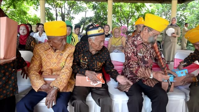 indonesians in the central island of sulawesi held a ceremony on thursday to remember those massacred by the dutch army during the 1940s war of... - malayan ethnicity stock videos and b-roll footage