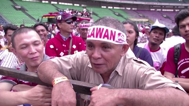 indonesians vote wednesday in the country's most pivotal presidential election since the downfall of dictator suharto, with jakarta governor joko... - human face video stock e b–roll