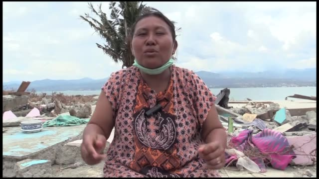 "indonesians who survived from the deadly earthquake and tsunami in sulawesi island indonesia cannot forget their lost relatives ""we couldn't find my... - 2004 stock-videos und b-roll-filmmaterial"