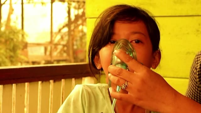 indonesians,including children affected by forest fires spewing toxic haze are suffering in villages with difficulties in breathing - malaysian ethnicity stock videos & royalty-free footage