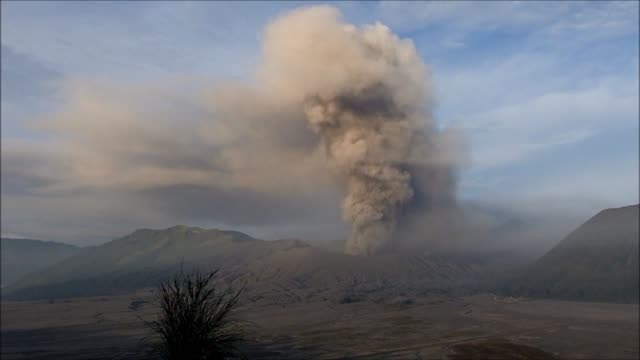 indonesias mount bromo spouts ash up to 1200 meters into the sky forcing the closure of the nearby airport according to the local reports - probolinggo stock videos & royalty-free footage