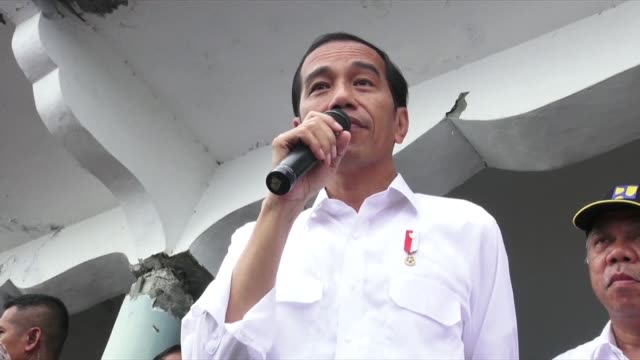 Indonesia's president Joko Widodo visits Pidie Jaya the district worst hit by a 65 magnitude earthquake two days ago and pledged to rebuild it soon