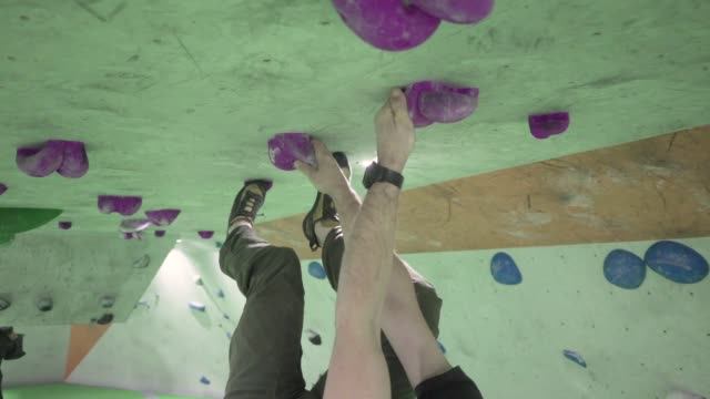 indoor climber climbing bouldering exercise leisure ceiling upside down gimbal - climbing wall stock videos & royalty-free footage