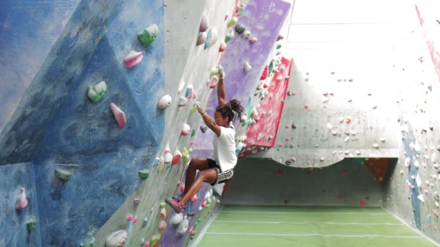 indoor climbing with hipster person - climbing wall stock videos & royalty-free footage