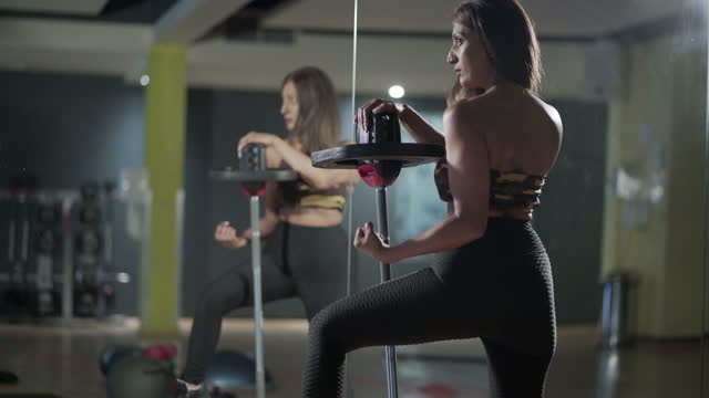 indoor fitness training flexing those muscles - showing off stock videos & royalty-free footage