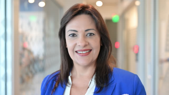 indoor portrait of smiling hispanic businesswoman - royal blue stock videos & royalty-free footage