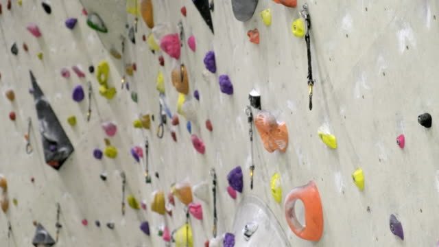 indoor rock climbing wall - climbing wall stock videos & royalty-free footage