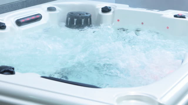 indoor spa tub working and water vapor coming out in winter - hot tub stock videos & royalty-free footage