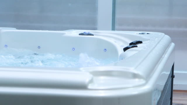 indoor spa tub working and water vapor coming out in winter - bathhouse stock videos & royalty-free footage