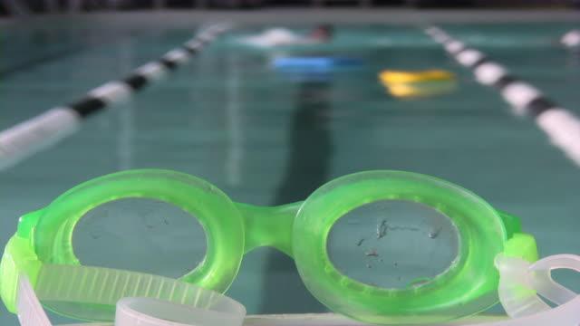 stockvideo's en b-roll-footage met indoor swimming pool, swim glass, float - binnenbad