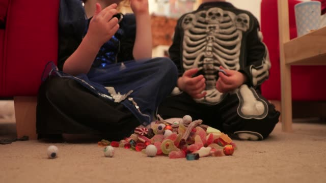 indulging in sweets on halloween - confectionery stock videos & royalty-free footage