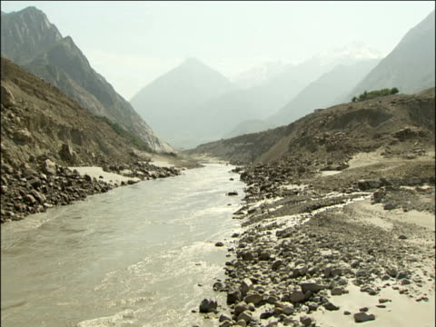 Indus river flows through rocky mountains