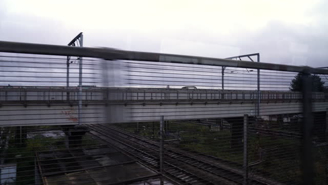 industrial area from train window - cinematography stock videos & royalty-free footage