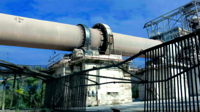 industrial area. part of functioning rotary kiln - kiln stock videos and b-roll footage