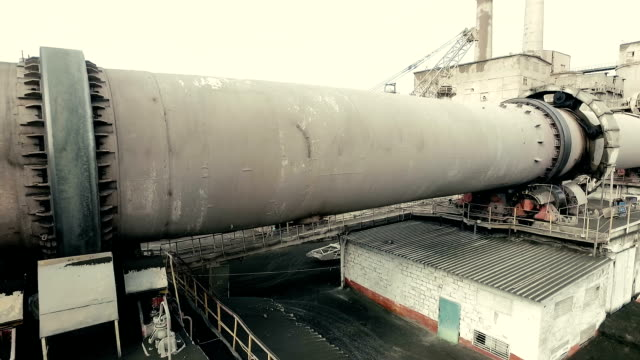 industrial area with functioning rotary kiln. aerial shooting - kiln stock videos and b-roll footage