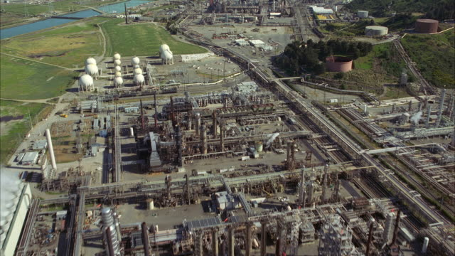 AERIAL Industrial area with oil refinery / San Francisco, California, USA