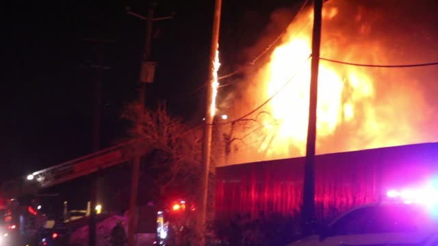 Industrial Building Fire With Flames