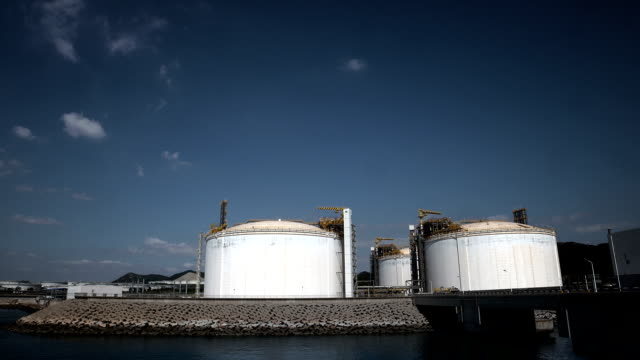 industrial building-lng oil gas equipment - storage tank stock videos and b-roll footage