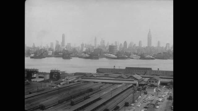 1954 industrial buildings on pier with manhattan skyline in background - 1954 stock videos & royalty-free footage