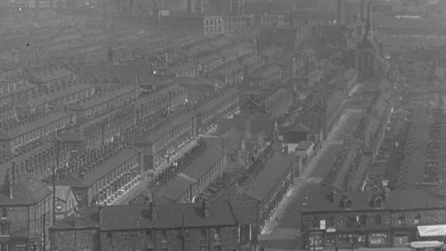 1951 montage industrial city of factories, rowhouses, and storefronts / united kingdom - terraced house stock videos & royalty-free footage