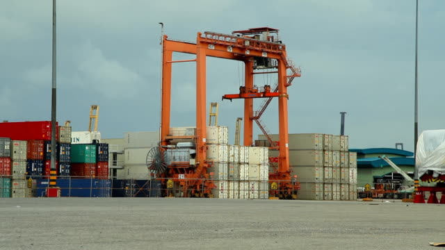industrial crane loading containers in a cargo freight ship - container stock videos & royalty-free footage