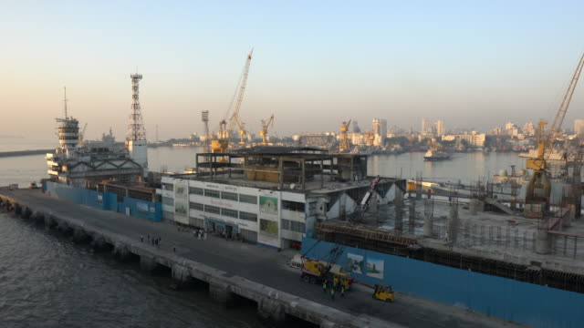 industrial cranes at sea port mumbai. - harbour stock videos & royalty-free footage