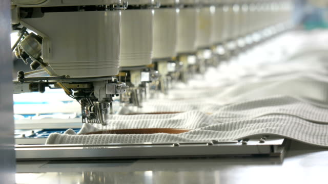 industrial embroidery machine in the textile factory - needle plant part stock videos & royalty-free footage