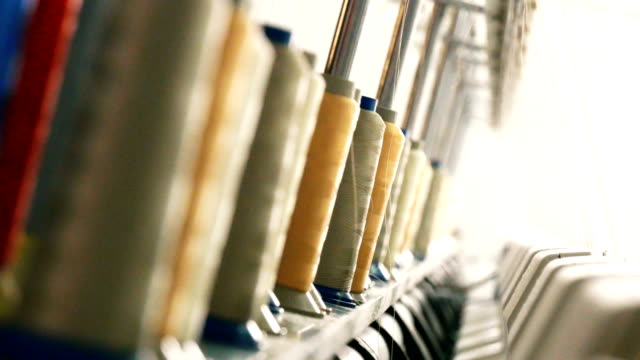 industrial embroidery machine in the textile factory - thread sewing item stock videos & royalty-free footage