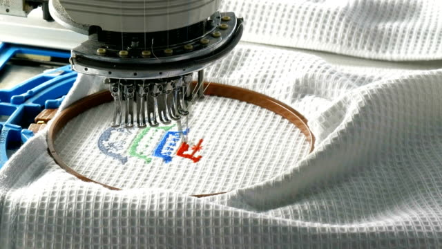 industrial embroidery machine in the textile factory - embroidery stock videos & royalty-free footage