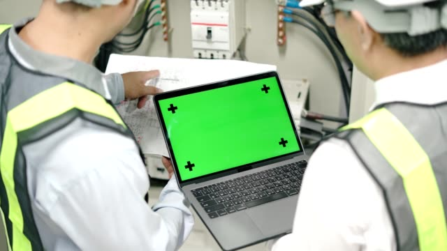 industrial engineer works on the personal computer with green mock-up screen - graphics tablet stock videos & royalty-free footage