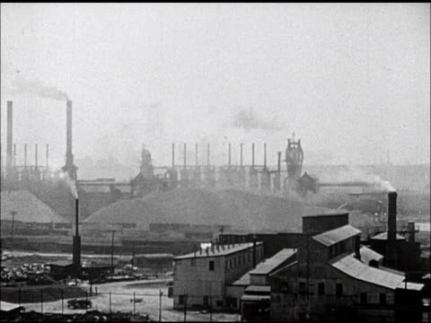 industrial factory w/ multiple stacks releasing white smoke air filled w/ smoke ws closer same factory possibly pulp paper mill environment... - paper industry stock videos & royalty-free footage