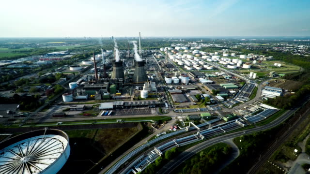 aerial: industrial field with oil refinery - refinery stock videos & royalty-free footage