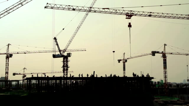 Industrial landscape with silhouettes of cranes